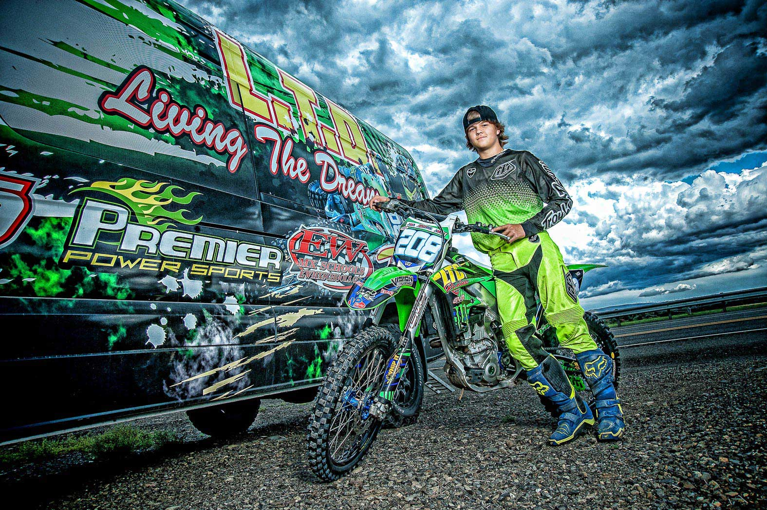 boy-standing-with-motorcycle-by-brightly-painted-van-during-motocross-senior-pictures