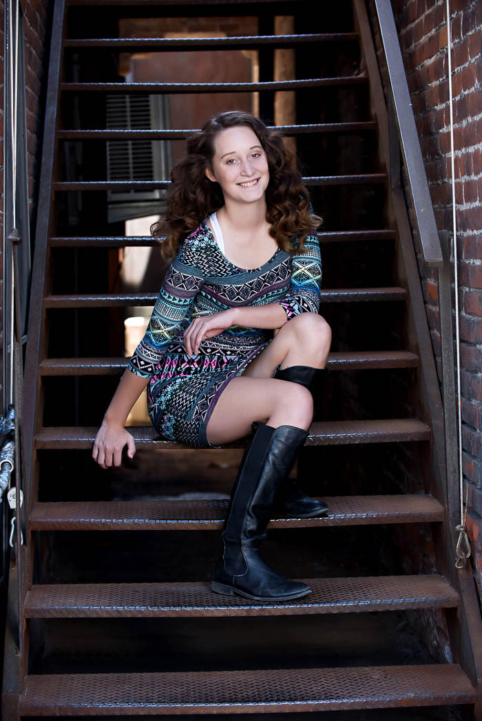 senior picture of girl sitting on metal stairs
