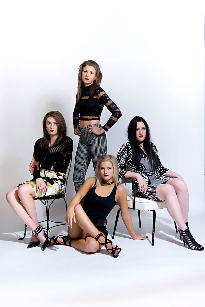 group of models wearing black and white during studio model shoot