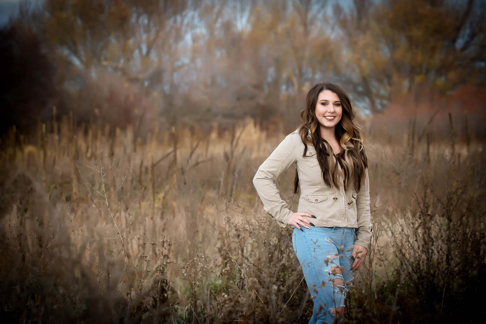 senior picture adventure with girl standing in grassy field