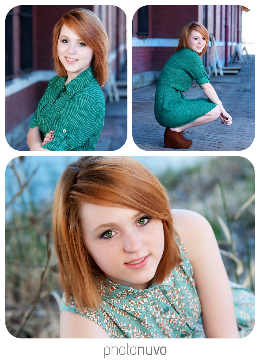 girl with red hair smiling at vintage train station during her senior portraits