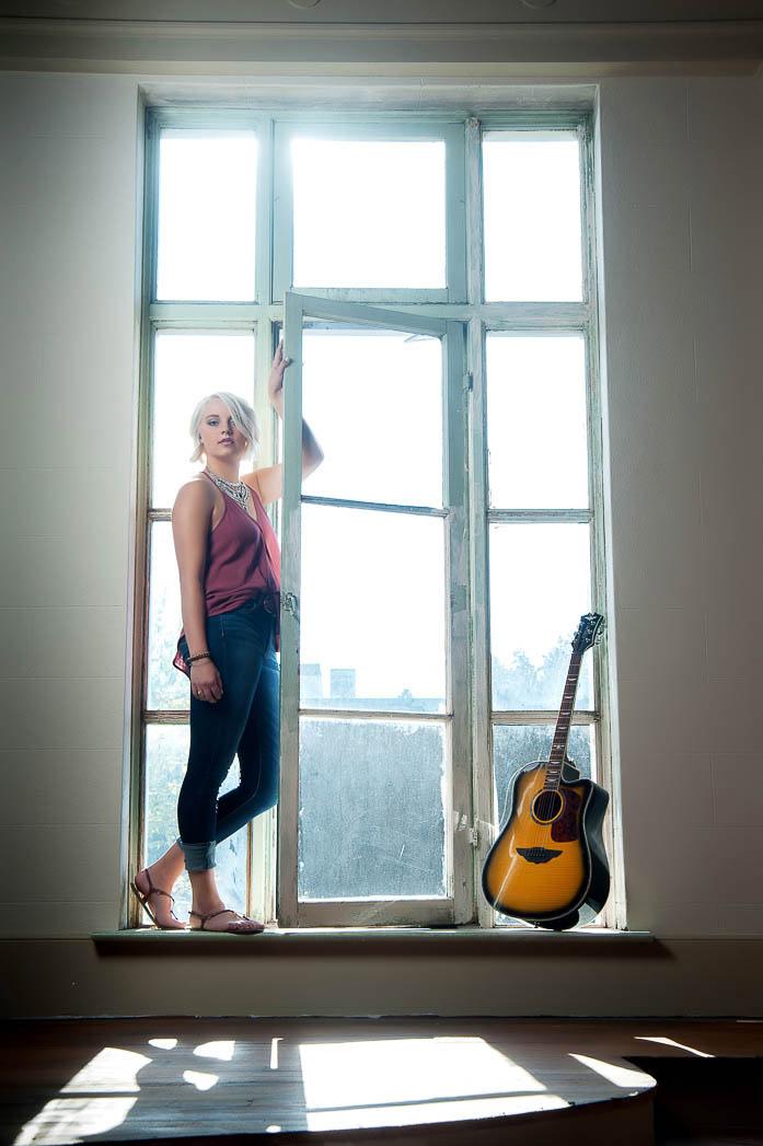 karina-senior-pictures-backlit-window-music-photonuvo