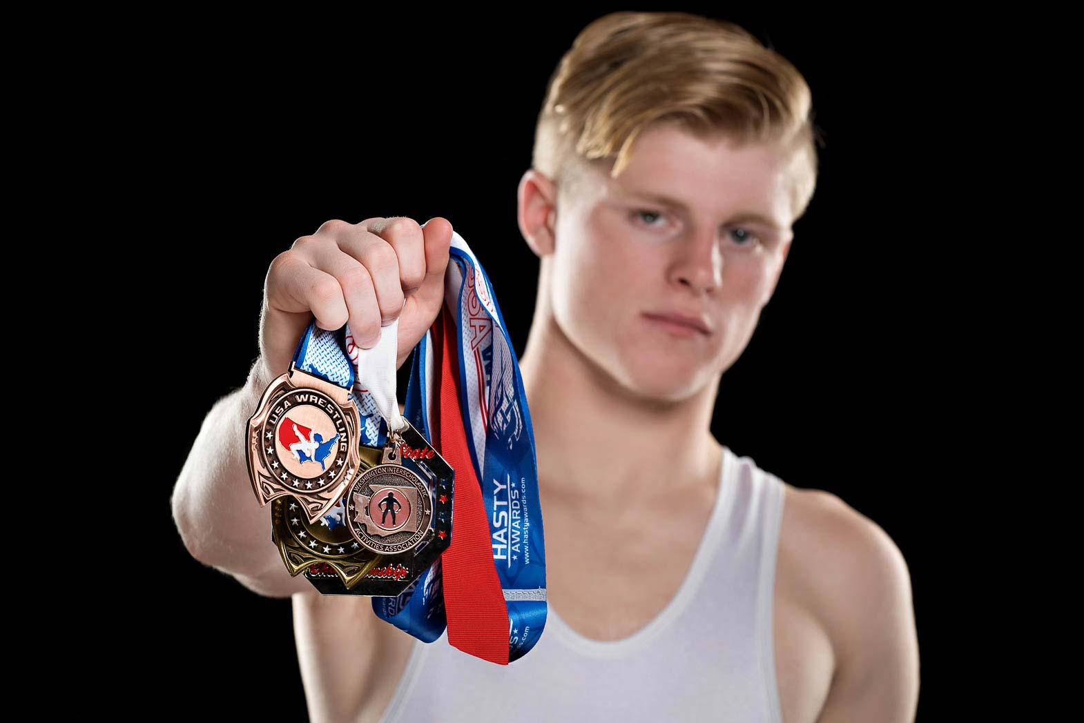 garrett-sports-senior-pictures-wrestling-awards-medals-studio-photonuvo