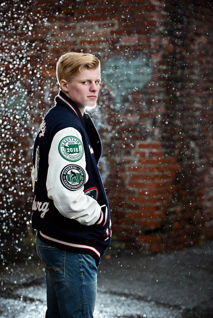 garrett-sports-senior-pictures-urban-rain-lettermans-jacket-backlight-photonuvo