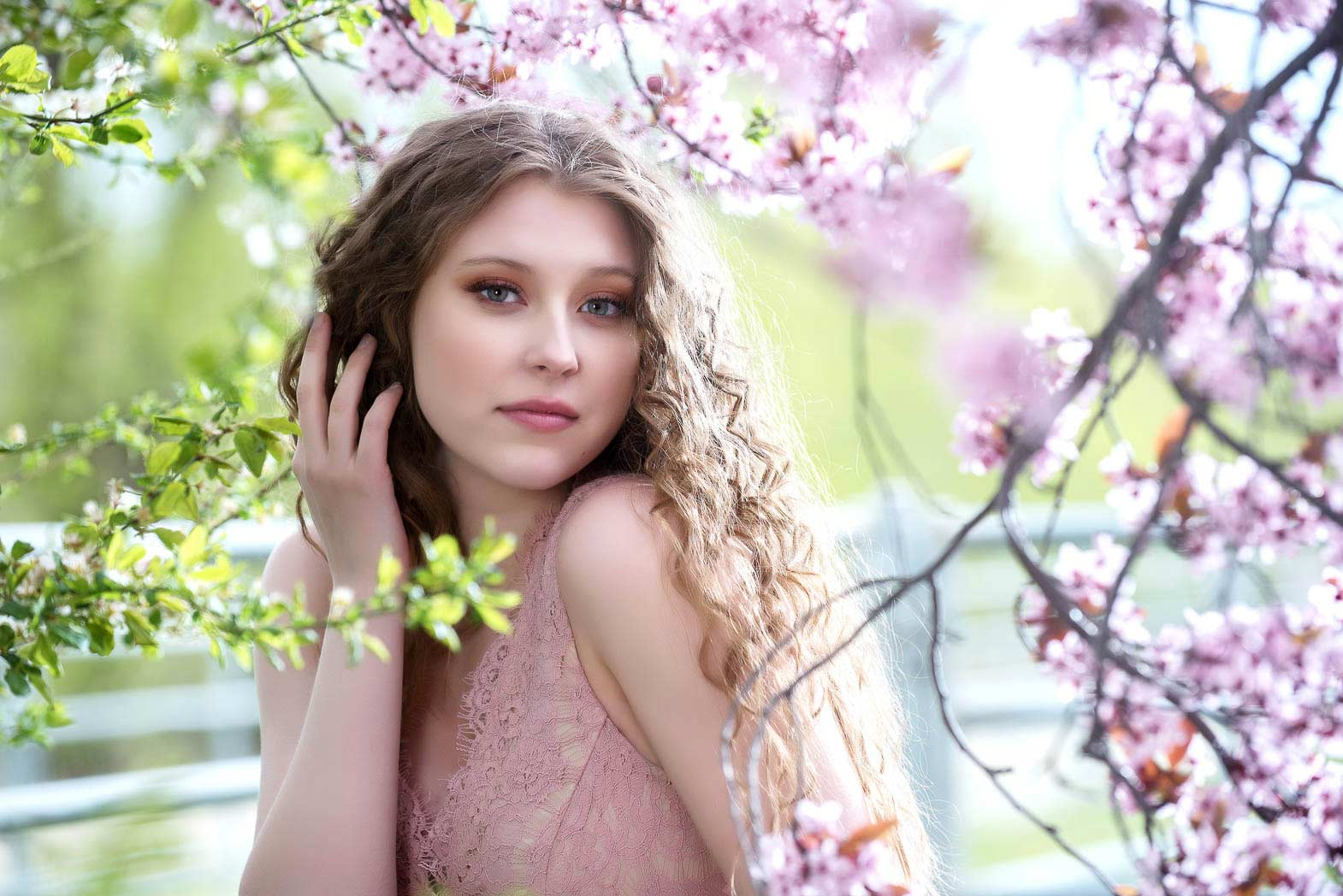 beautiful senior model surrounded by flowers