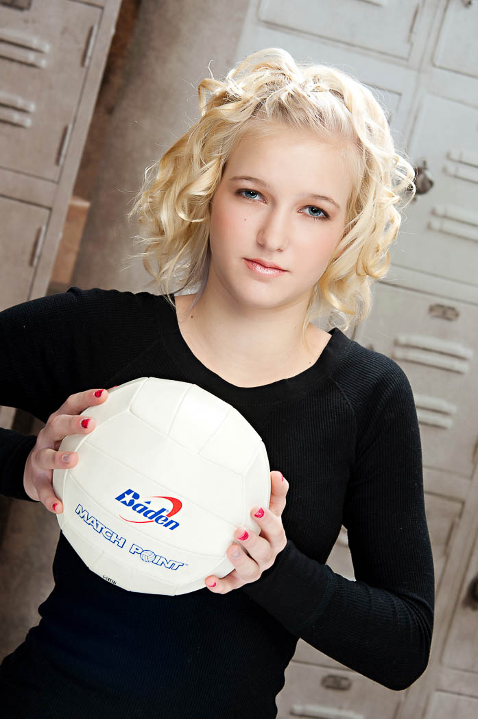 birthday portrait party sports picture of young girl holding a volleyball