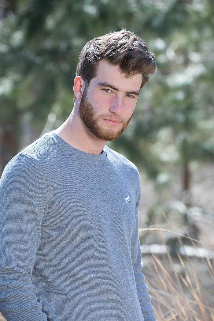 guy looking intensely at camera during exciting senior picture session