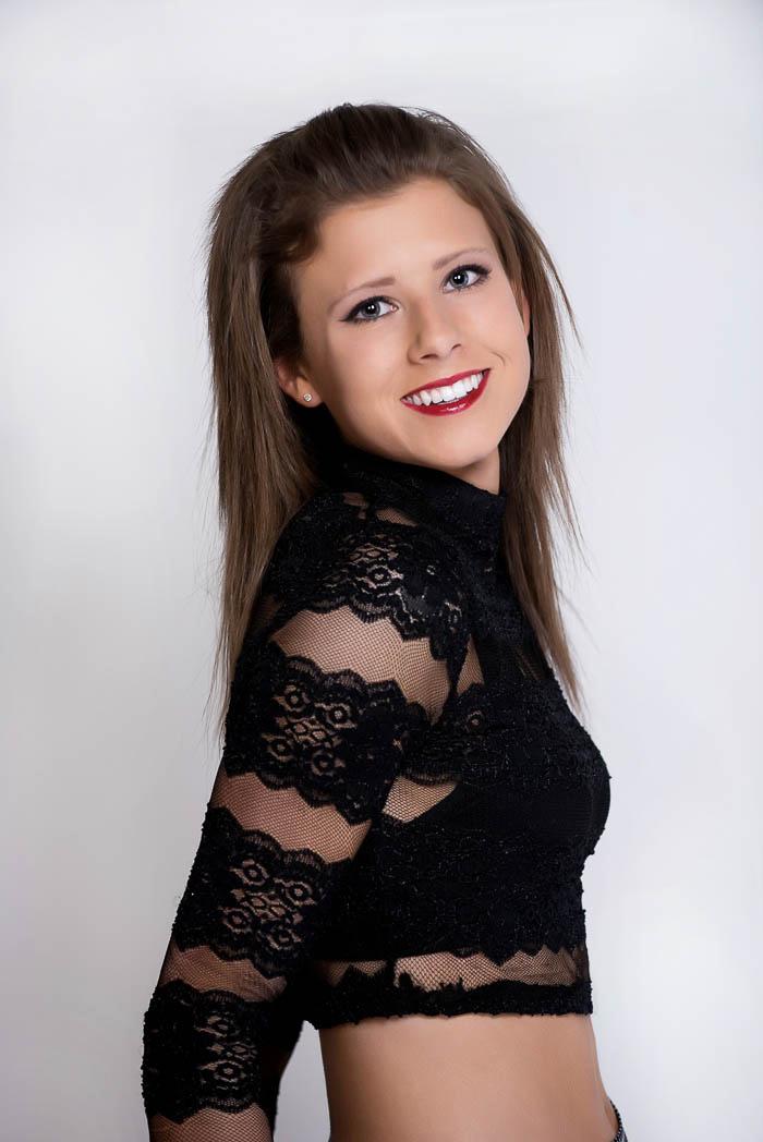 senior girl smiling during studio model shoot