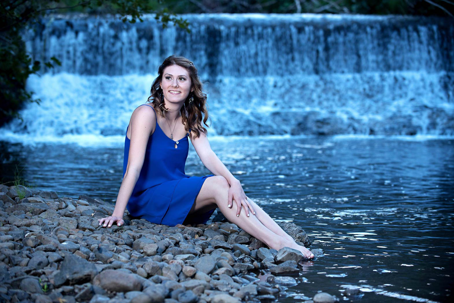 waterfall senior picture of girl on bank of river